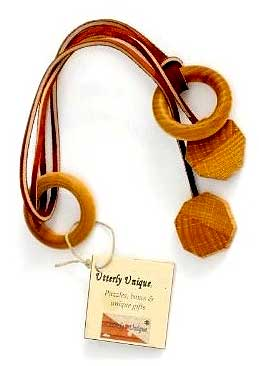 Ring Release - Wood Disentanglement Puzzle by Utterly Unique